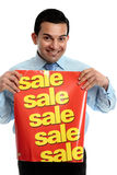 Retailer with sale sign Royalty Free Stock Images