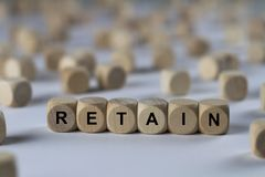Retain - cube with letters, sign with wooden cubes Royalty Free Stock Photography