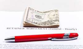 Retainer Agreement with Dollars and pen. Retainer Agreement with American Dollars and pen royalty free stock photo
