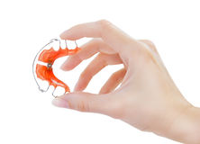 Retainer for teeth. Hand holding retainer for teeth Stock Image