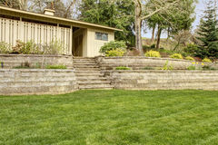 Retaining brick wall with steps and garage.. Stock Photography
