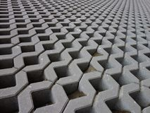 Concrete permeable grid pavers, close-up. Retaining wall made of permeable reinforced concrete units. Lawn grid Stock Photo