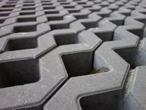 Concrete permeable grid pavers, close-up. Retaining wall made of permeable reinforced concrete units. Lawn grid Royalty Free Stock Photography