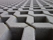 Concrete permeable grid pavers, close-up stock photography