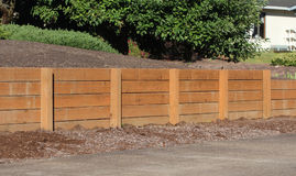 Retaining Wall made of wood. Retaining wall made of sturdy wood to prevent erosion between neighbors yards Stock Photography
