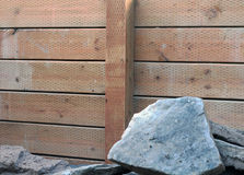 Retaining Wall made of wood. Retaining wall made of sturdy wood to prevent erosion between neighbors yards Royalty Free Stock Image