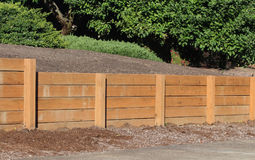 Retaining Wall made of wood. Retaining wall made of sturdy wood to prevent erosion between neighbors yards Royalty Free Stock Photography