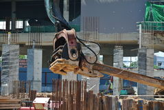 Retaining wall steel sheet pile cofferdam installation by machine Stock Photo