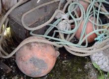 Rete da pesca con i galleggianti nel granaio Immagini Stock