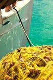 Rete da pesca e barca Immagini Stock