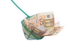 Rete da pesca riempita di euro note Immagini Stock