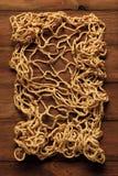Rete da pesca sulla scheda di legno anziana Fotografie Stock