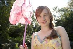 Rete della farfalla della holding di picnic Fotografie Stock Libere da Diritti
