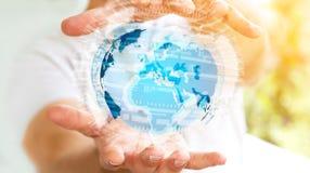 Rete globale della tenuta dell'uomo d'affari sulla rappresentazione del pianeta Terra 3D Immagine Stock