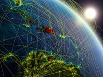 Rete intorno alla Repubblica dominicana da spazio illustrazione di stock