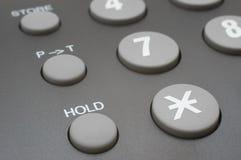 Retenez le bouton (le clavier de téléphone) Photographie stock