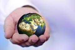 Retenir le globe Photo stock