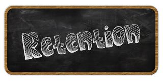 RETENTION written in chalk on blackboard. Wood frame. Royalty Free Stock Images