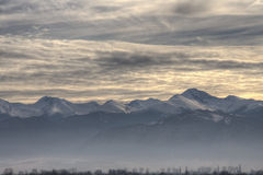 Retezat Mountains. Cloudscape over snow capped Retezat mountains, Retezat National Park in Romania Stock Images
