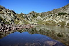 Retezat National Park. Mountain Reflection in a Lake Stock Image
