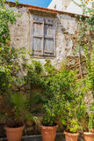 Rethymno, Greece - August  4, 2016:  Ancient building and trees. Royalty Free Stock Photography