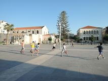 Rethymno, Greece - june 15, 2017: boys teenagers of different nationalities playing football on a Sunny evening in the city center stock photos