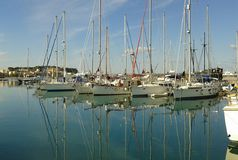 Rethymno Harbour. Crete. Greecd. Winter& x27;s day. Yachts. Marina. Calm water. Tall masts Stock Photography