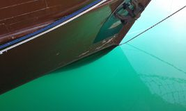 Rethymno harbour. Green sea water. Rethymno harbour. Crete. Greece. Calm water. Brown boat. Hull Stock Photography