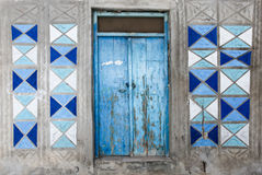 Rethymno, Island Crete, Greece, - June 23, 2016: Traditional Greek facade of house with blue wooden door and blue and white colore. Traditional Greek facade of royalty free stock photography