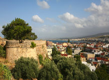 Rethymnon city and castle wall. A panoramic view of Rethymnon city on Crete, Greece, with part of the Fortezza castle wall on the left Royalty Free Stock Photography