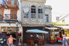 Rethymnon, Island Crete, Greece, - July 1, 2016: The old buildings with small cafes and shops are located in the street of part Ol Stock Image
