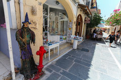 Rethymnon, Island Crete, Greece, - July 1, 2016: The scarecrow near the store on narrow street of Rethymnon part of Old Town whe Royalty Free Stock Photos