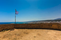 Rethymnon, Island Crete, Greece, - June 23, 2016: View on the inside part of Fortezza Castle in Rethymnon and the national flag of Stock Images