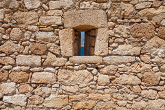 Rethymnon, Island Crete, Greece, - June 23, 2016: View on the stone wall with a narrow window of Fortezza Castle in Rethymnon Stock Images