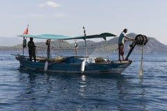 Reti dei pesci e del pescatore Fotografia Stock