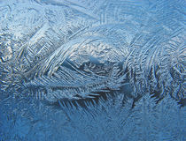 Reticolo gelido sulla lastra di vetro Immagini Stock