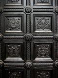 Reticolo nero del portello della casa Fotografia Stock