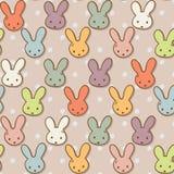 Reticolo senza cuciture con i conigli svegli Fondo variopinto del coniglietto Fotografia Stock Libera da Diritti