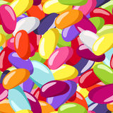 Reticolo senza cuciture con i fagioli di gelatina colorati. Immagine Stock Libera da Diritti