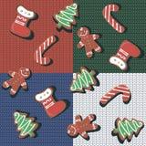 Reticolo senza giunte Biscotti del pan di zenzero di Natale su un fondo tricottato Coperta a quadretti della lana rappezzatura Na royalty illustrazione gratis