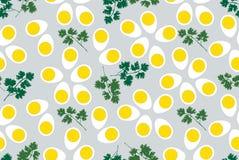 Reticolo senza giunte con le uova ed il prezzemolo Fotografia Stock