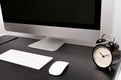 Retina display with keyboard, mouse and alarm clock royalty free stock images
