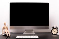 Retina display with keyboard, mouse, alarm clock and wood man Stock Image