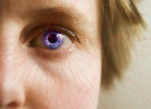 Retina Scan. Red lines scanning the face and retina of a woman with the word 'Scanning...' in a text box Stock Photo