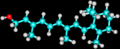 Retinol (Vitamin A) molecular structure on black. Retinol, the form of vitamin A absorbed when eating animal food sources, is a yellow, fat-soluble substance Royalty Free Stock Photo