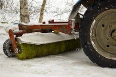 Retirada de la nieve automática de los tractores Imagenes de archivo