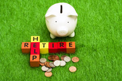 Retire and Help. Alphabet blocks spelling retire and help with a piggy bank and coins Stock Images
