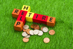 Retire and Help. Alphabet blocks spelling retire and help Royalty Free Stock Image