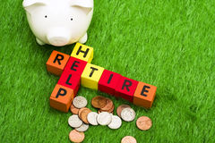 Retire and Help. Alphabet blocks spelling retire and help Stock Photos