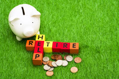 Retire and Help. Alphabet blocks spelling retire and help Royalty Free Stock Photography